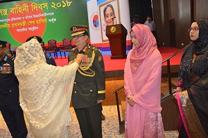 Hon'ble Prime Minister is awarding peacetime medal to a award holder from Bangladesh Army​​​​​